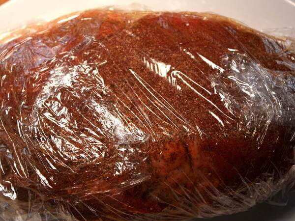 Seasoned Cross Rib Roast Wrapped In Plastic Wrap, Waiting To Go Into The Smoker
