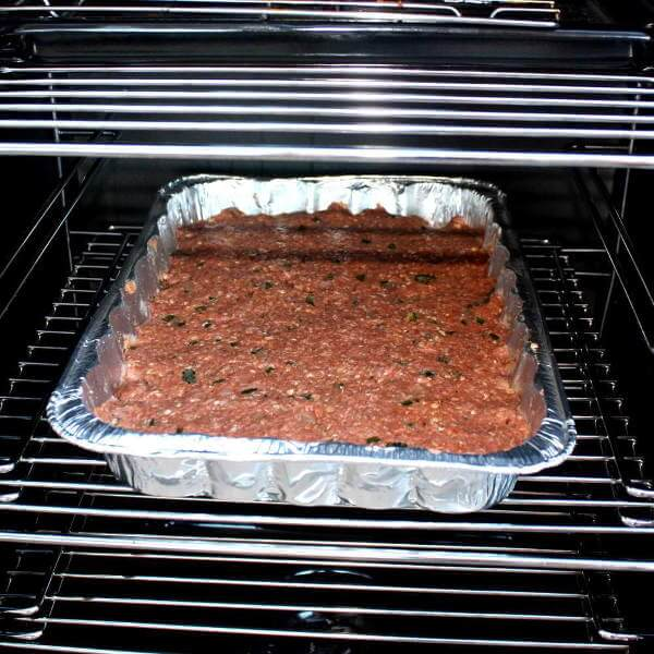 Meatloaf That Just Went Into The Smoker, Pressed Into a Disposable Aluminum Pan, In a CharBroil Propane Smoker