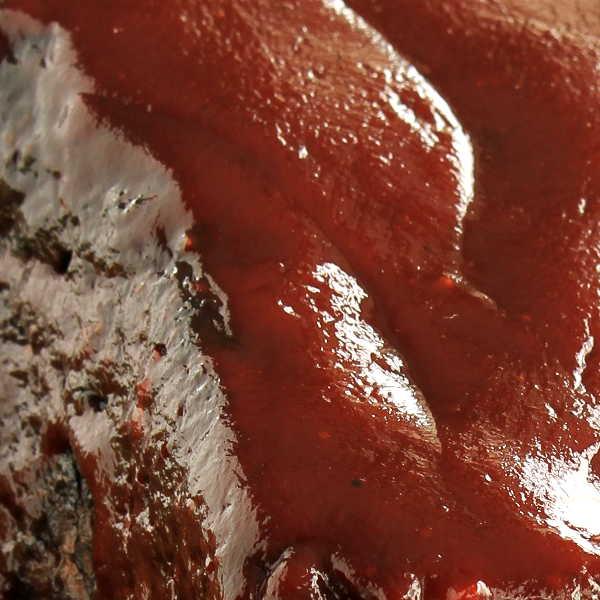 Texas style Barbecue Sauce Glopped On Smoked Brisket