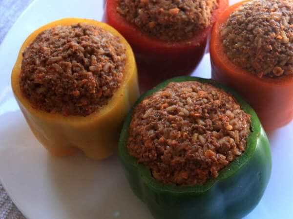 Four Stuffed Bell Peppers, Filling Still Uncooked, Before Being Placed In The Smoker