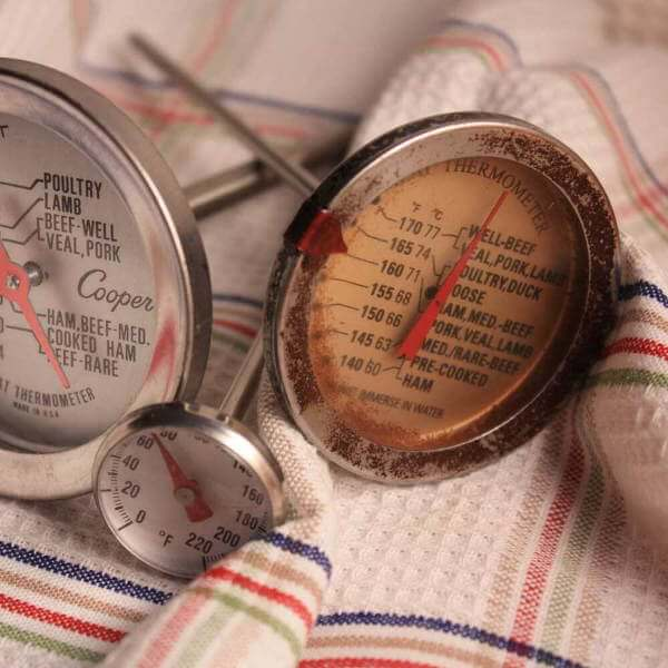 Three Dial Type Cooking Thermometers On Dish Towel