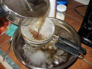 Pouring a Spice and Herb Tea Through Strainers
