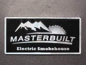 Masterbuilt Electric Smoker Logo Plaque, Showing Image of Sun Setting Behind Mountains