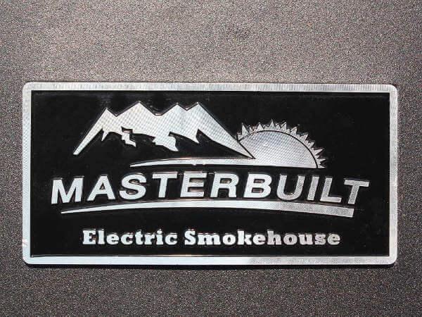 Masterbuilt Electric Smoker Logo Plaque, Showing Image of Sun Setting Behind Mountains