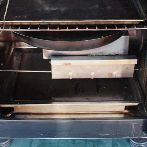Image Showing Electric Element Box, With Woodchip Smoker Tube and Water Pan Positioned Above