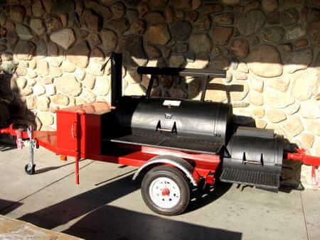 Wood Burning Pit Smoker Mounted on Red Single Axle Trailer