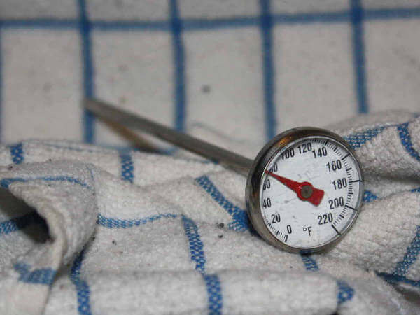 Analog Dial Pocket Food Thermometer On a Blue Trimmed Towel