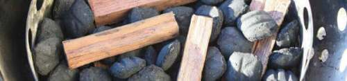 Charcoal Briquettes and Smoker Wood Chunks In a WSM