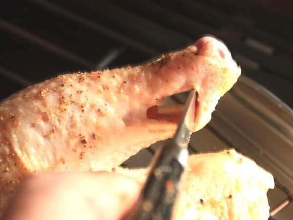 Cutting an Opening In Chicken Leg, Used To Truss a Whole Chicken