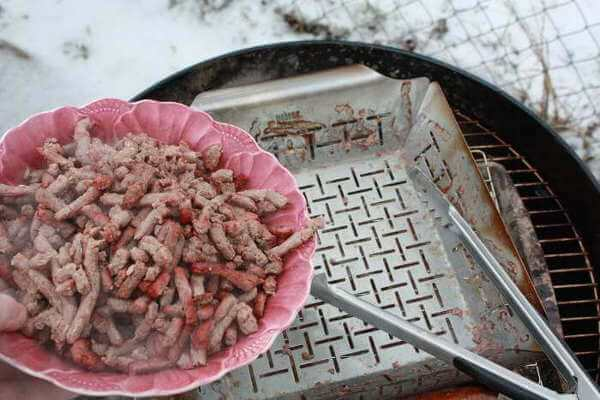 Removing Smoked Chili Meat From Smoker Pan Into Bowl