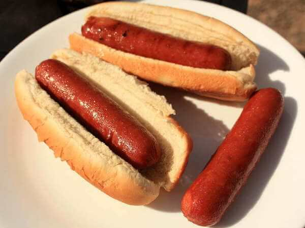 Plump and Juicy Smoked Polish Sausage Links on White Bread Buns