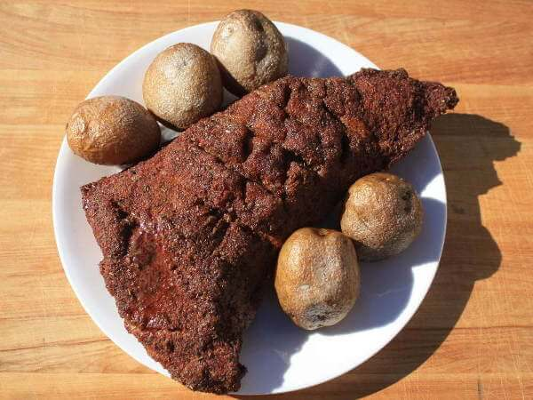 Smoked Potatoes On a Platter With a Smoked Beef Tri Tip Roast