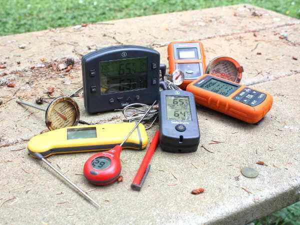 An Assortment of Digital and Analog Thermometers Used With My Smoker