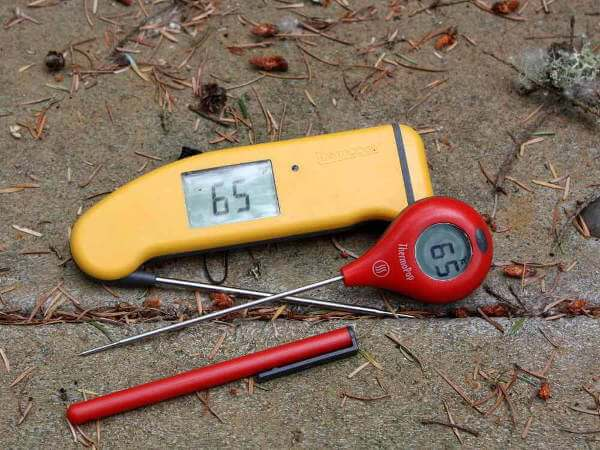 A Yellow ThermoWorks ThermaPen Mk4 and a Red ThermoPop Thermometers On a Picnic Table