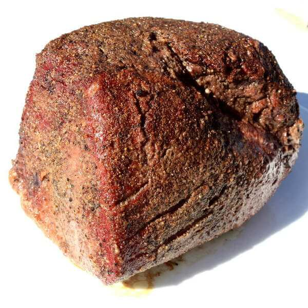Grill Smoked Beef Top Round Roast, On a White Plate Sitting In The Bright, Bright Sunshine