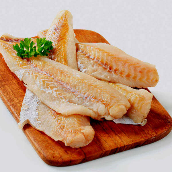 Raw Catfish Fillets On Cutting Board
