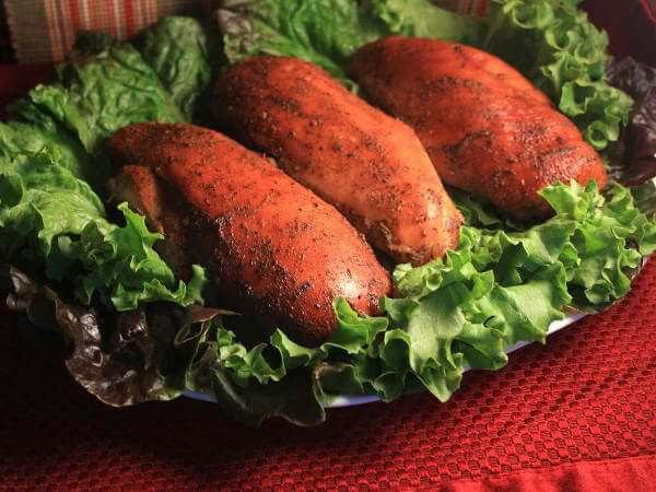 Three Smoked Chicken Breasts on Bed of Green Leaf Lettuce