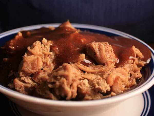 Pulled Pork Shoulder In Bowl, Covered With Red BBQ Sauce
