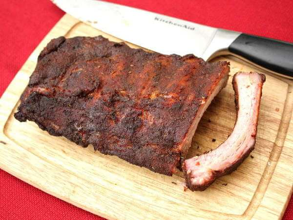 Smoked Baby Back Ribs on Cutting Board With Knife