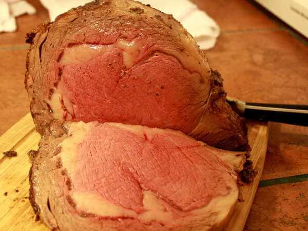 Grilled Beef Rib Roast, Sliced, On Cutting Board
