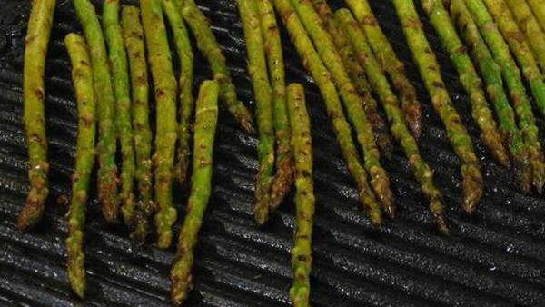 Grilling Asparagus Spears On a Cast Iron Griddle