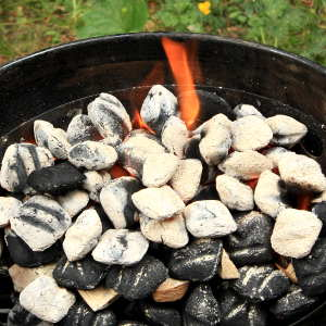 Fire Ring In Weber Smoker Filled With Burning Charcoal and Smoker Wood