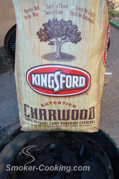 Kingsford Lump Charcoal in Bag Set Upon Weber Smoker Base