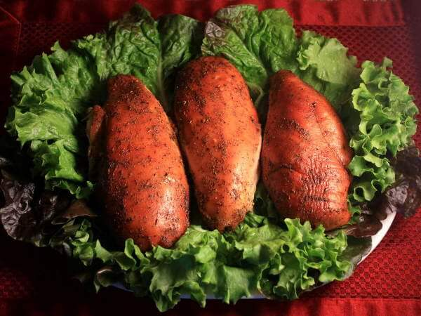 Three Smoked Chicken Breasts on Bed of Lettuce