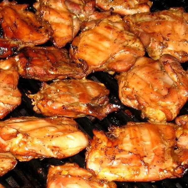 Skinless, Bone-In Chicken Thighs Being Grill-Smoked In a High-End Gas Grill