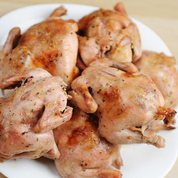 Smoked Cornish Game Hens On a White Plate