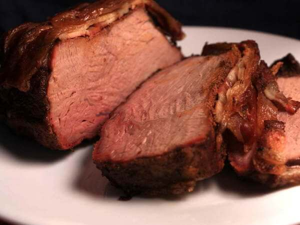 Smoked Bacon Covered Beef Chuck Cross Rib Roast, Sliced And On Serving Platter