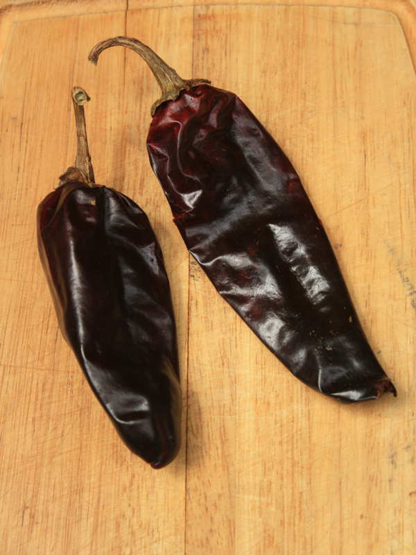 Dried New Mexico Chile Pods On Cutting Board