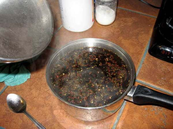 Chicken Brine That Has Simmered In Saucepan, On Kitchen Counter