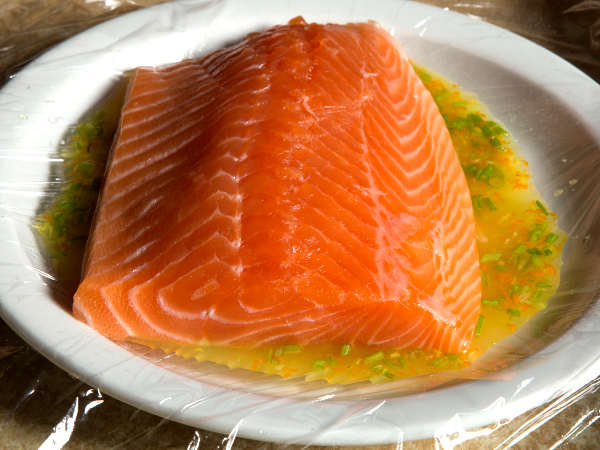 Marinating a Salmon Fillet In a White Bowl