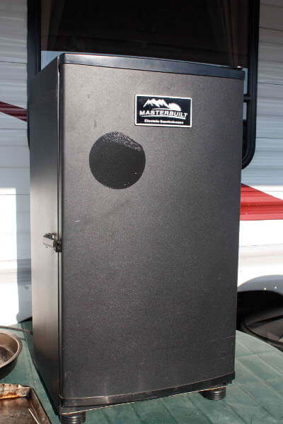 Black Masterbuilt Digital Electric Smoker In Front of Travel Trailer