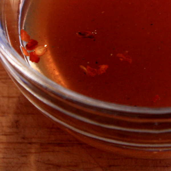 Spicy Vinegar Based BBQ Sauce In a Glass Bowl