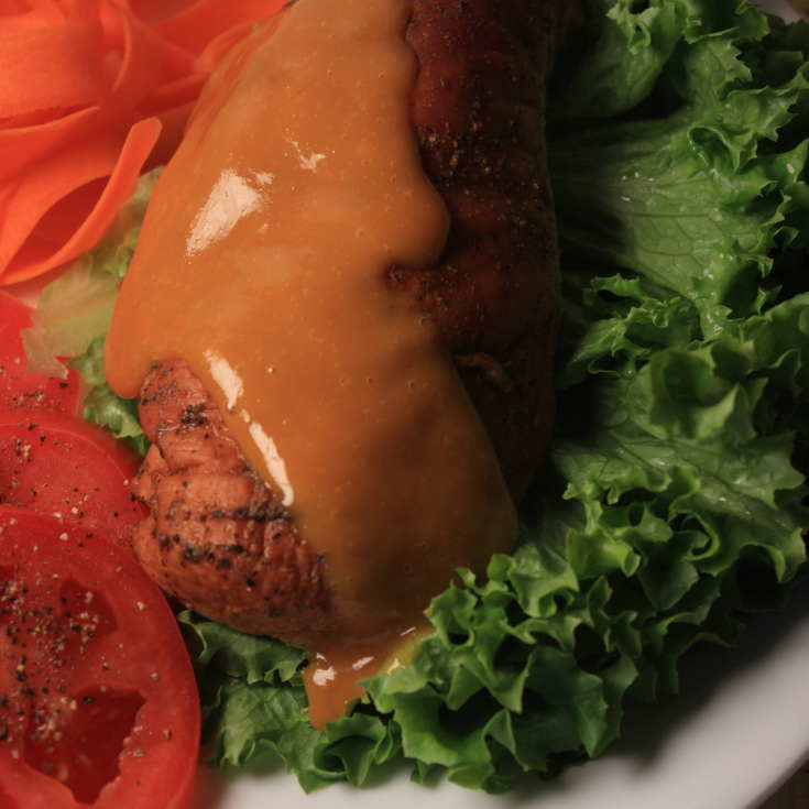 Tangy Yellow Mustard BBQ Sauce Dripping Down a Smoked Chicken Breast