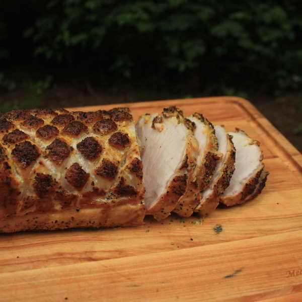 Grilled Whole Pork Loin On a Bamboo Cutting Board