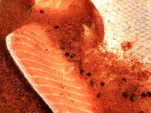 Salmon Fillets Soaking In a Liquid Brine Solution