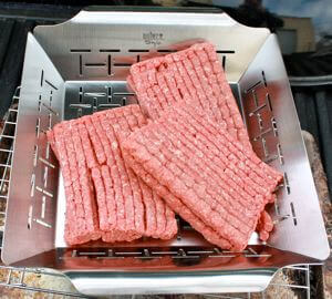 Raw Coarse Ground Beef In a Grill Pan, Ready To Be Smoked