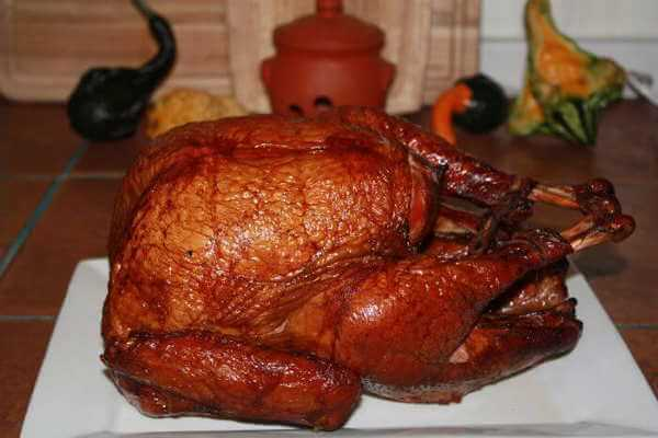 Turkey Resting On Countertop After Being Cooked In a Weber Smokey Mountain Cooker