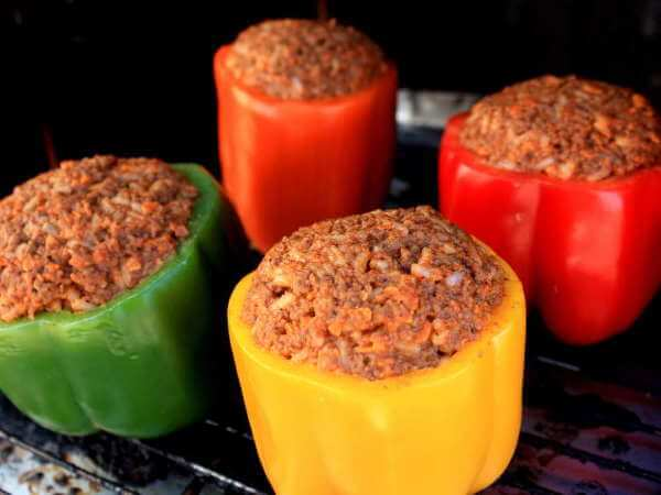 Sweet Bell Peppers - Yellow, Red, Orange and Green, Stuffed With a Meat-Based Filling, Set Upon a Char-Broil Smoker Rack