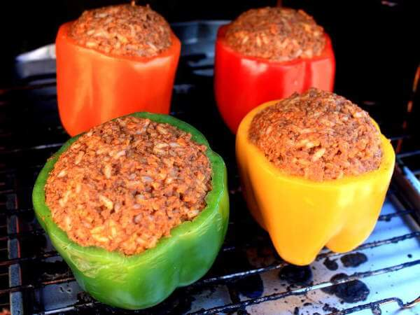 Uncooked Green, Orange, Red and Yellow Bell Peppers, Stuffed With a Well Seasoned and Precooked Ground Beef Mixture