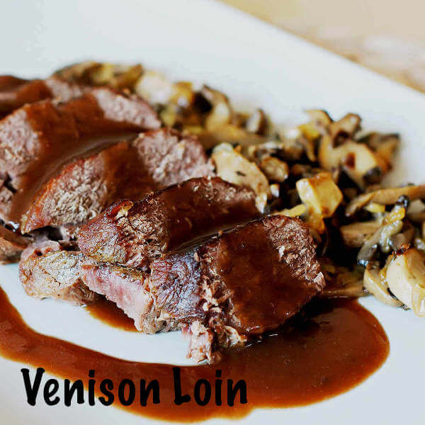 Stuffed Venison Backstrap On Platter With Mushrooms and Gravy