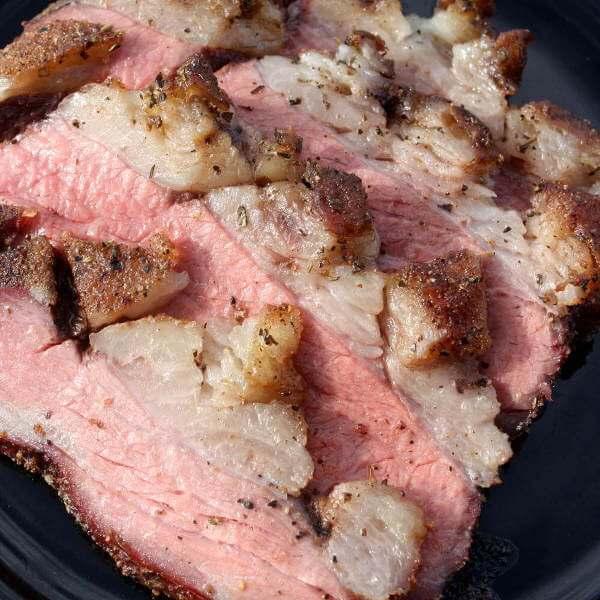 Smoked, Sliced Tri Tip Roast on Black Plate