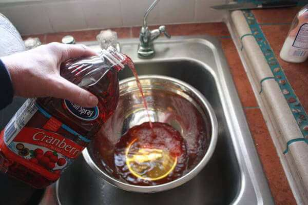 Making Cranberry-Apple Turkey Brine, Pouring Ocean Spray Into Stainless Steel Bowl