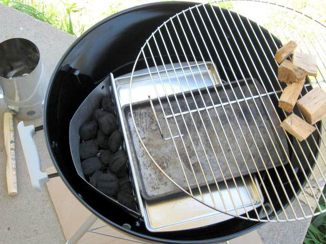 Weber Kettle Set Up For Indirect Grilling With Charcoal Banked on One Side
