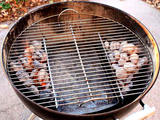 Weber Kettle With Charcoal In Baskets on Two Sides of Grill