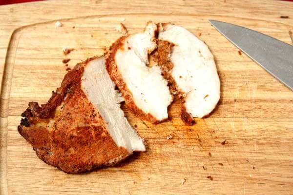 Smoked Wild Turkey Breast On Cutting Board With Chef's Knife