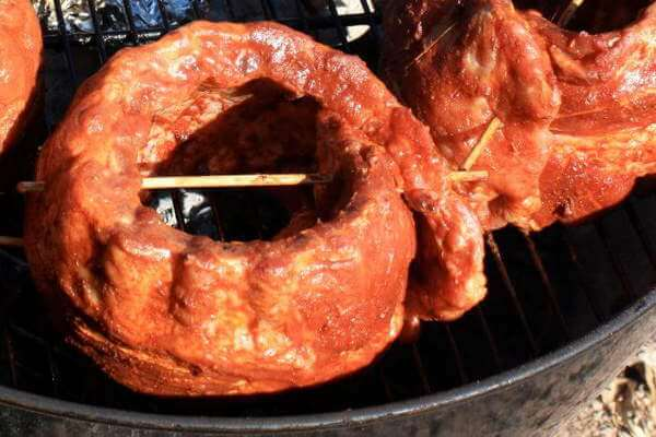 Baby Back Ribs Being Smoked Using a Water Pan For Maintaining Moistness